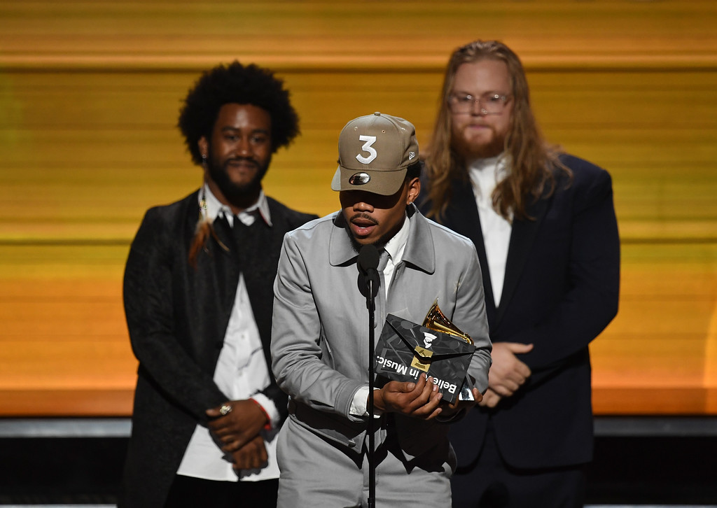 . LOS ANGELES, CA - FEBRUARY 12:  Recording artist Chance the Rapper (C) accepts the Best New Artist award onstage during The 59th GRAMMY Awards at STAPLES Center on February 12, 2017 in Los Angeles, California.  (Photo by Kevin Winter/Getty Images for NARAS)