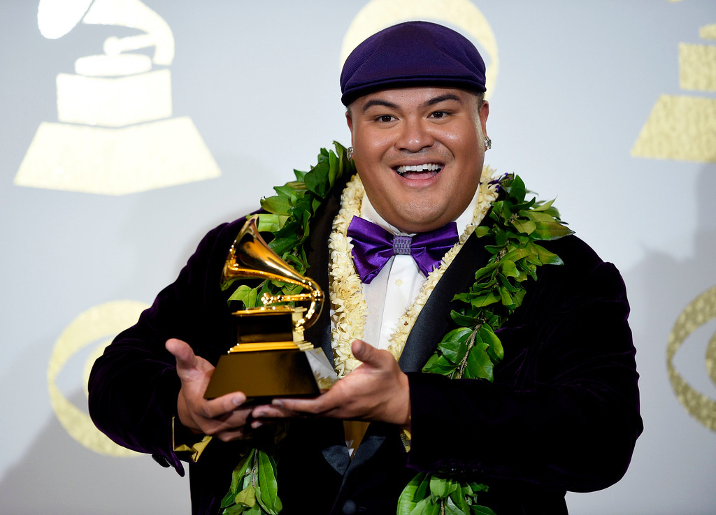 """. Kalani Pe\'a poses in the press room with the award for best regional roots music album for \""""E Walea\"""" at the 59th annual Grammy Awards at the Staples Center on Sunday, Feb. 12, 2017, in Los Angeles. (Photo by Chris Pizzello/Invision/AP)"""