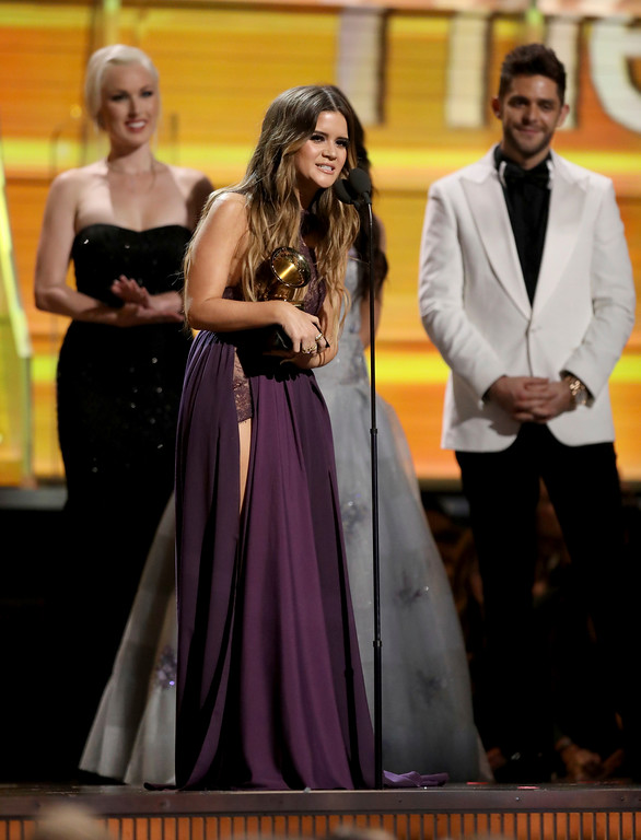 """. Maren Morris accepts the award for best country solo performance for \""""My Church\"""" at the 59th annual Grammy Awards on Sunday, Feb. 12, 2017, in Los Angeles. (Photo by Matt Sayles/Invision/AP)"""