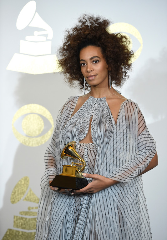 """. Solange poses in the press room with the award for best R&B performance for \""""Cranes in the Sky\"""" at the 59th annual Grammy Awards at the Staples Center on Sunday, Feb. 12, 2017, in Los Angeles. (Photo by Chris Pizzello/Invision/AP)"""