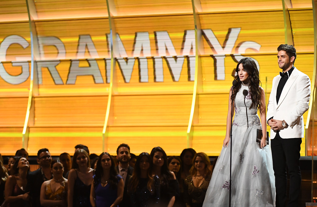 . LOS ANGELES, CA - FEBRUARY 12: Recording artists Camila Cabello (L) and Thomas Rhett speak onstage during The 59th GRAMMY Awards at STAPLES Center on February 12, 2017 in Los Angeles, California.  (Photo by Kevork Djansezian/Getty Images)