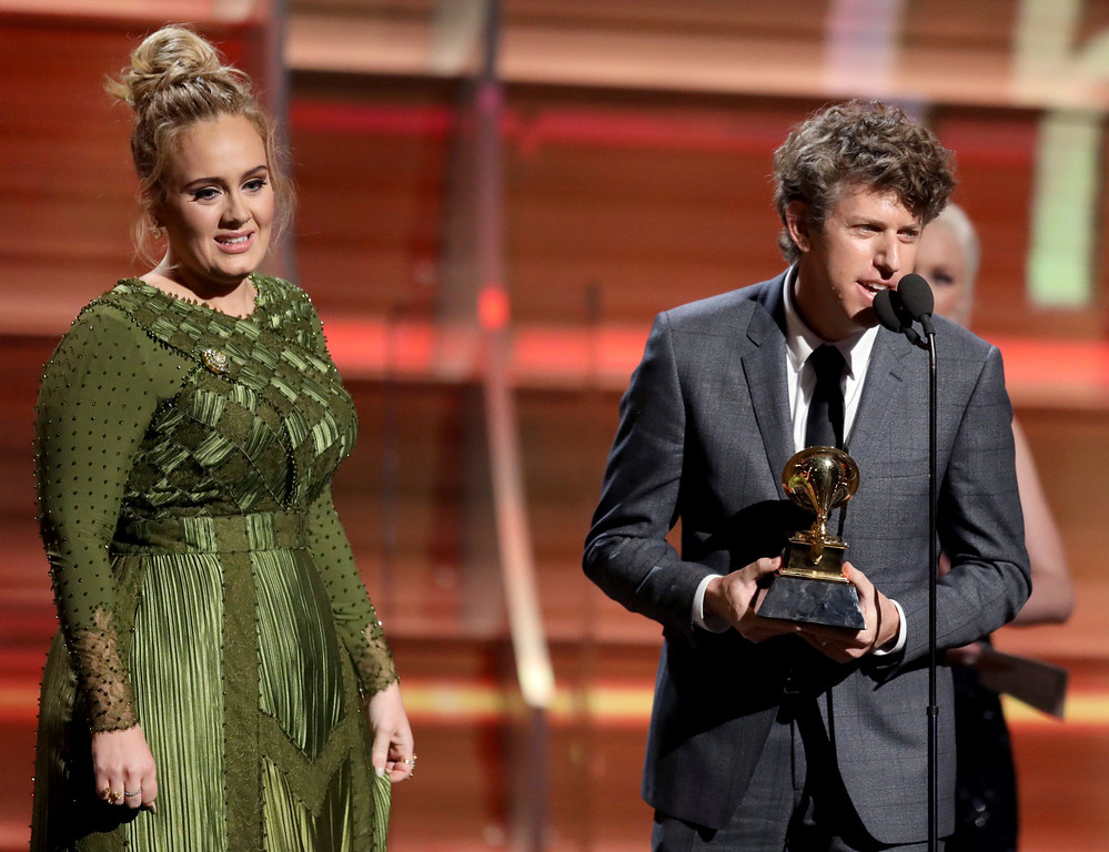 ". Greg Kurstin, right, and Adele accept the award for song of the year for ""Hello\"" at the 59th annual Grammy Awards on Sunday, Feb. 12, 2017, in Los Angeles. (Photo by Matt Sayles/Invision/AP)"