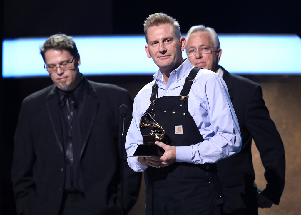 """. Rory Feek accepts the award for best roots gospel album for \""""Hymns\"""" at the 59th annual Grammy Awards on Sunday, Feb. 12, 2017, in Los Angeles. (Photo by Matt Sayles/Invision/AP)"""