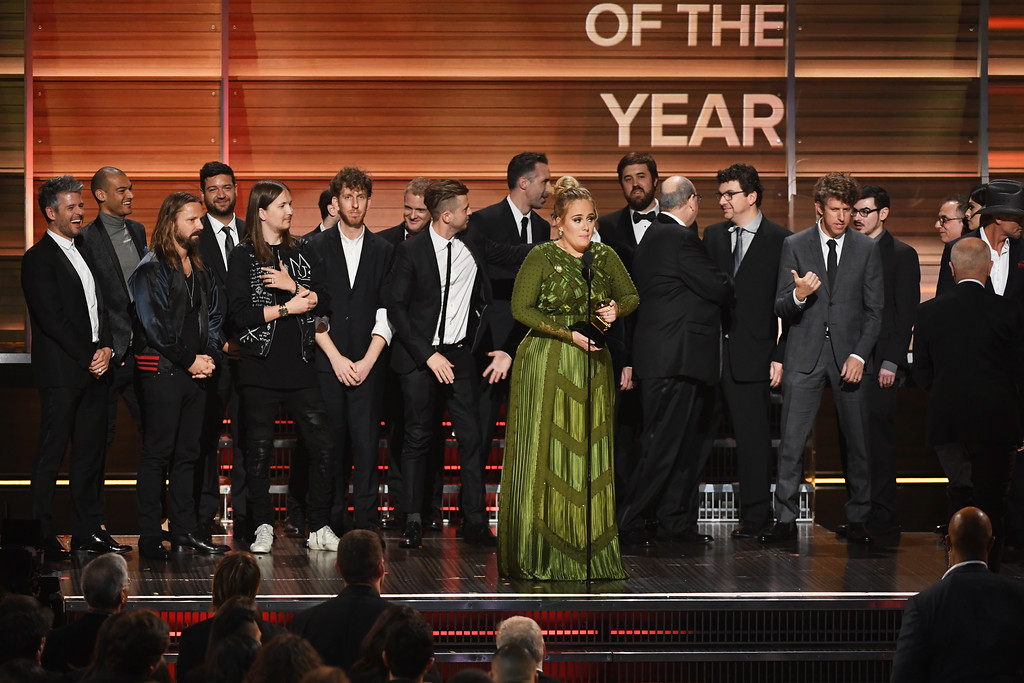 . LOS ANGELES, CA - FEBRUARY 12:  Recording artist Adele (C) accepts the Album Of The Year award for \'25\' onstage during The 59th GRAMMY Awards at STAPLES Center on February 12, 2017 in Los Angeles, California.  (Photo by Kevin Winter/Getty Images for NARAS)