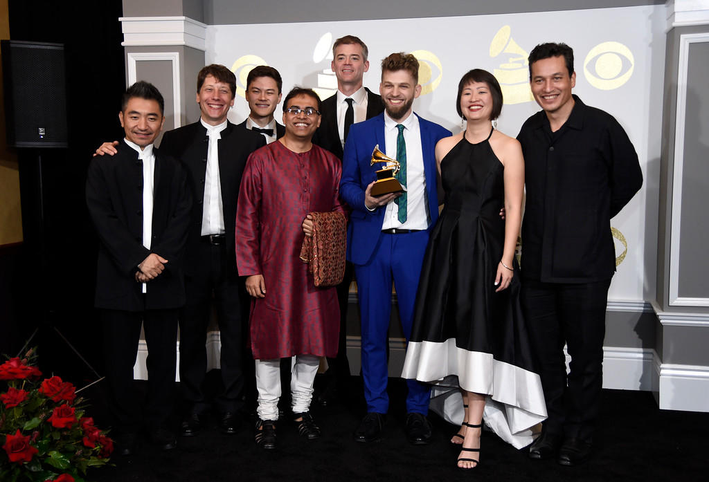""". Members of the Silk Road Ensemble pose in the press room with the award for best world music album for \""""Sing Me Home\"""" at the 59th annual Grammy Awards at the Staples Center on Sunday, Feb. 12, 2017, in Los Angeles. (Photo by Chris Pizzello/Invision/AP)"""