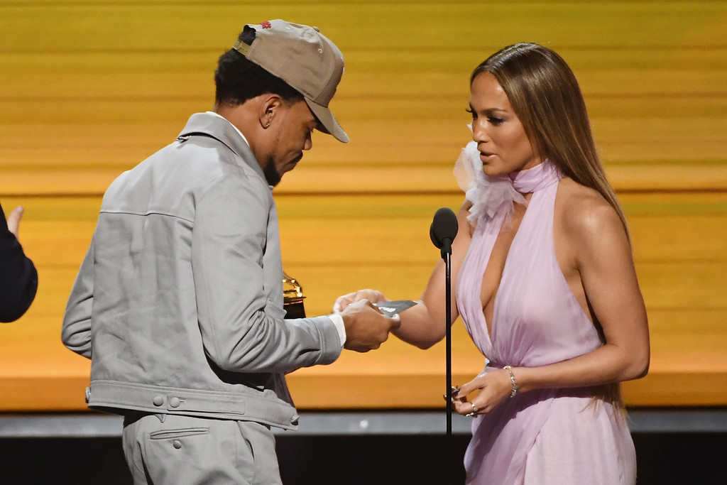 . LOS ANGELES, CA - FEBRUARY 12:  Recording artist-actor Jennifer Lopez (R) presents the Best New Artist award to recording artist Chance the Rapper onstage during The 59th GRAMMY Awards at STAPLES Center on February 12, 2017 in Los Angeles, California.  (Photo by Kevin Winter/Getty Images for NARAS)