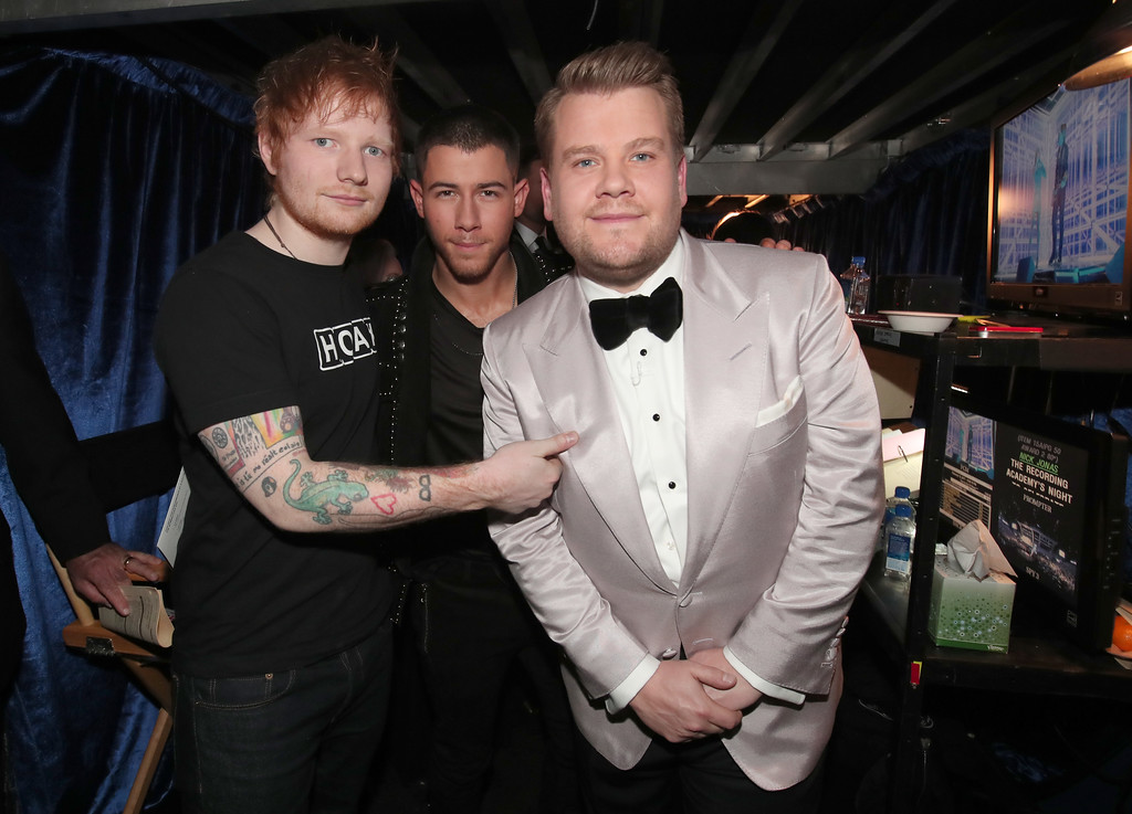 . LOS ANGELES, CA - FEBRUARY 12:  (L-R) Singer Ed Sheeran, singer/actor Nick Jonas and GRAMMY Awards host James Corden attend The 59th GRAMMY Awards at STAPLES Center on February 12, 2017 in Los Angeles, California.  (Photo by Christopher Polk/Getty Images for NARAS)