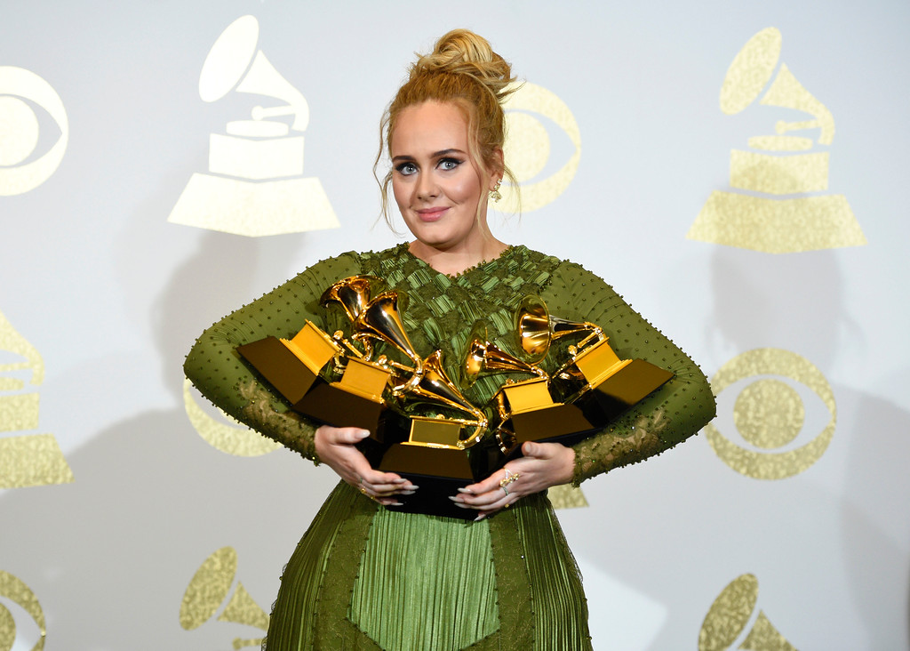 ". Adele poses in the press room with the awards for album of the year for ""25\"", song of the year for \""Hello\"", record of the year for \""Hello\"", best pop solo performance for \""Hello\"", and best pop vocal album for \""25\"" at the 59th annual Grammy Awards at the Staples Center on Sunday, Feb. 12, 2017, in Los Angeles. (Photo by Chris Pizzello/Invision/AP)"