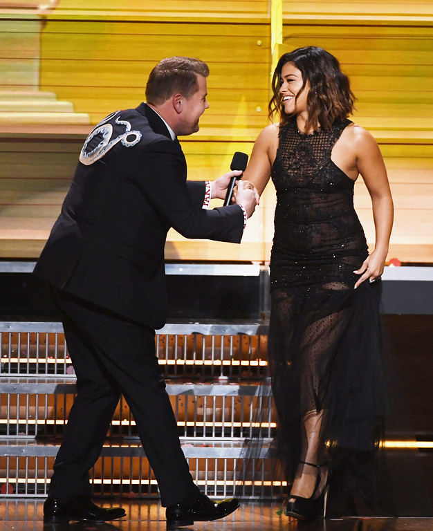 . LOS ANGELES, CA - FEBRUARY 12:  Host James Corden (L) greets actor Gina Rodriguez onstage during The 59th GRAMMY Awards at STAPLES Center on February 12, 2017 in Los Angeles, California.  (Photo by Kevin Winter/Getty Images for NARAS)