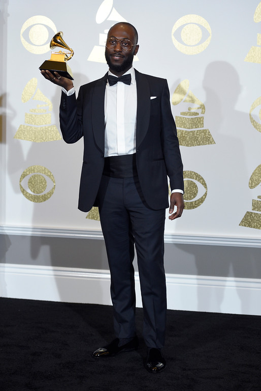""". Paul Jefferies poses in the press room with the award for best rap song for \""""Hotline Bling\"""" at the 59th annual Grammy Awards at the Staples Center on Sunday, Feb. 12, 2017, in Los Angeles. (Photo by Chris Pizzello/Invision/AP)"""