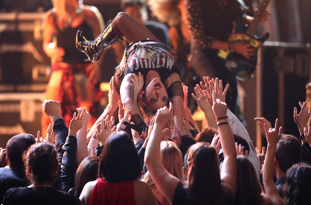""". Lady Gaga crowd surfs as she performs \""""Moth Into Flame\"""" at the 59th annual Grammy Awards on Sunday, Feb. 12, 2017, in Los Angeles. (Photo by Matt Sayles/Invision/AP)"""