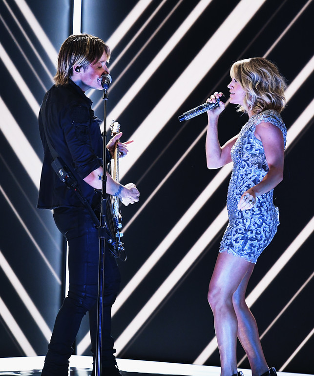 . LOS ANGELES, CA - FEBRUARY 12:  Recording artists Keith Urban (L) and Carrie Underwood perform onstage during The 59th GRAMMY Awards at STAPLES Center on February 12, 2017 in Los Angeles, California.  (Photo by Kevin Winter/Getty Images for NARAS)