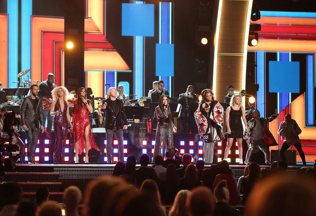 """. Jimi Westbrook, from left, Kimberly Schlapman, Karen Fairchild, and Philip Sweet of \""""Little Big Town\"""", Demi Lovato, Andra Day and Tori Kelly perform a tribute to the Bee Gees at the 59th annual Grammy Awards on Sunday, Feb. 12, 2017, in Los Angeles. (Photo by Matt Sayles/Invision/AP)"""
