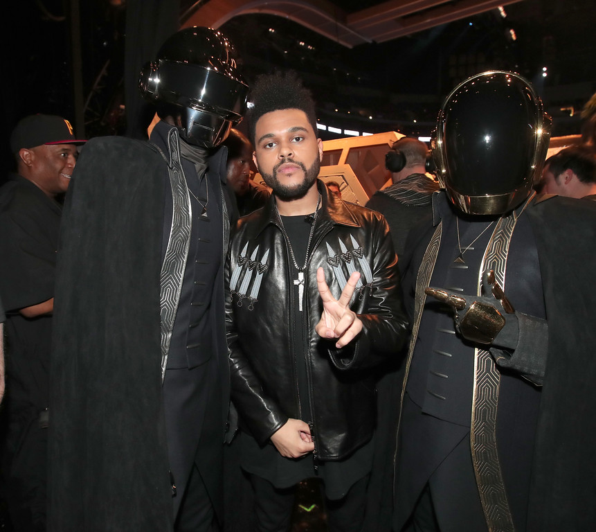 . LOS ANGELES, CA - FEBRUARY 12:  Musicians Daft Punk and The Weeknd (C) attend The 59th GRAMMY Awards at STAPLES Center on February 12, 2017 in Los Angeles, California.  (Photo by Christopher Polk/Getty Images for NARAS)