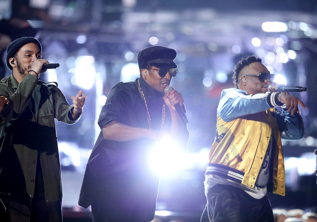 . Anderson .Paak, from left, Q-Tip, and Phife Dawg, from A Tribe Called Quest, perform at the 59th annual Grammy Awards on Sunday, Feb. 12, 2017, in Los Angeles. (Photo by Matt Sayles/Invision/AP)