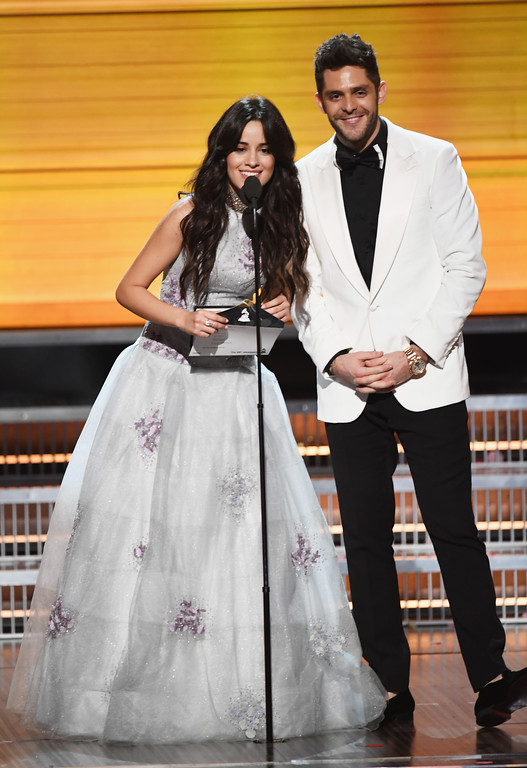 . LOS ANGELES, CA - FEBRUARY 12:  Recording artists Camila Cabello (L) and Thomas Rhett speak onstage during The 59th GRAMMY Awards at STAPLES Center on February 12, 2017 in Los Angeles, California.  (Photo by Kevin Winter/Getty Images for NARAS)