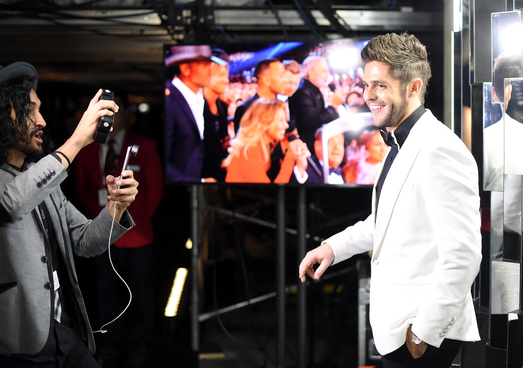 . LOS ANGELES, CA - FEBRUARY 12: Jonny Cruz (L) and singer-songwriter Thomas Rhett attend The 59th GRAMMY Awards at STAPLES Center on February 12, 2017 in Los Angeles, California.  (Photo by Frazer Harrison/Getty Images for NARAS)