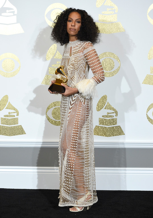 """. Melina Matsoukas poses in the press room with the award for best music video for \""""Formation\"""" by Beyonce at the 59th annual Grammy Awards at the Staples Center on Sunday, Feb. 12, 2017, in Los Angeles. (Photo by Chris Pizzello/Invision/AP)"""