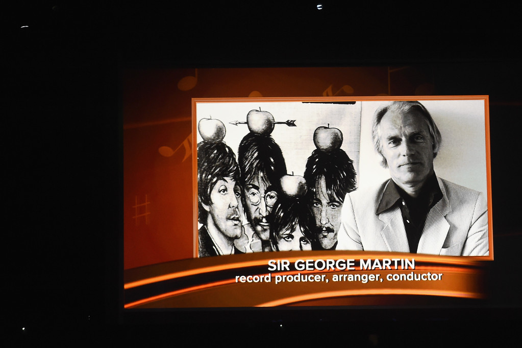 . LOS ANGELES, CA - FEBRUARY 12:  An image of the late Sir George Martin is projected on a video screen during The 59th GRAMMY Awards at STAPLES Center on February 12, 2017 in Los Angeles, California.  (Photo by Kevin Winter/Getty Images for NARAS)