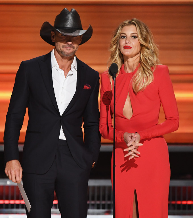 . LOS ANGELES, CA - FEBRUARY 12:  Recording artists Tim McGraw (L) and Faith Hill speak onstage during The 59th GRAMMY Awards at STAPLES Center on February 12, 2017 in Los Angeles, California.  (Photo by Kevin Winter/Getty Images for NARAS)