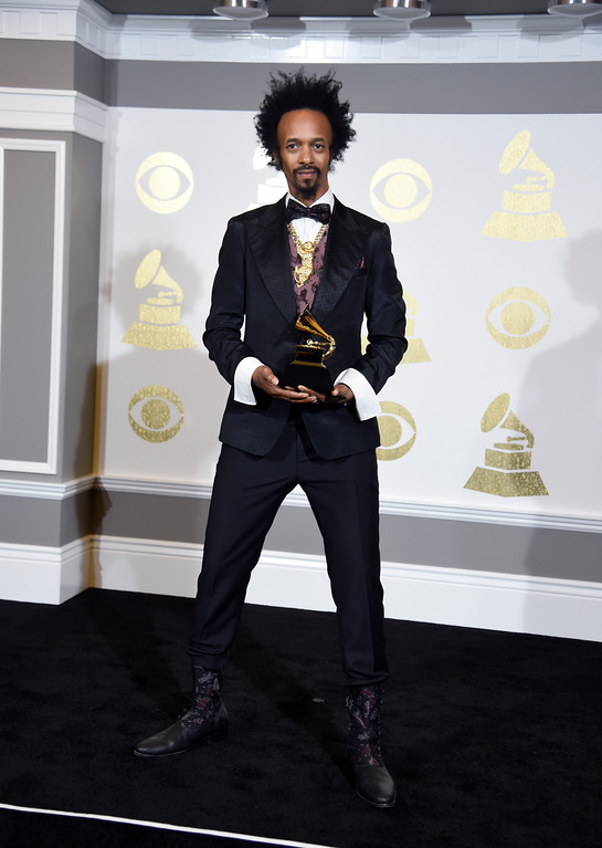 ". Fantastic Negrito poses in the press room with the award for best contemporary blues album for ""The Last Days of Oakland\"" at the 59th annual Grammy Awards at the Staples Center on Sunday, Feb. 12, 2017, in Los Angeles. (Photo by Chris Pizzello/Invision/AP)"
