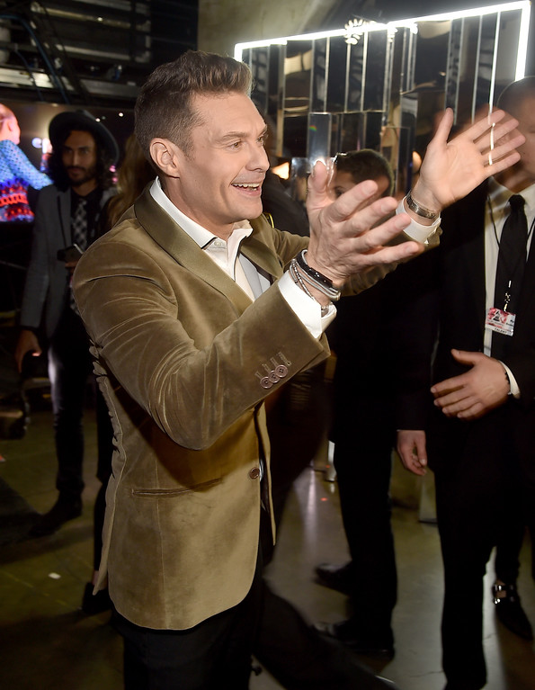. LOS ANGELES, CA - FEBRUARY 12:  Radio personality Ryan Seacrest walks backstage at The 59th GRAMMY Awards at STAPLES Center on February 12, 2017 in Los Angeles, California.  (Photo by Alberto E. Rodriguez/Getty Images for NARAS)