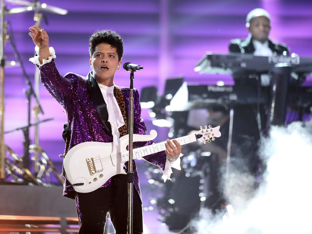 """. Bruno Mars performs \""""Let\'s Go Crazy\"""" during a tribute to Prince at the 59th annual Grammy Awards on Sunday, Feb. 12, 2017, in Los Angeles. (Photo by Matt Sayles/Invision/AP)"""