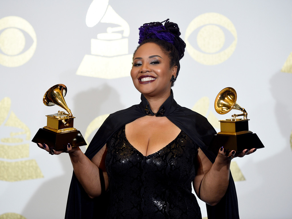 ". Lalah Hathaway poses in the press room with the awards for best traditional R&B performance for ""Angel\"" and best R&B album for \""Lalah Hathaway Live\"" at the 59th annual Grammy Awards at the Staples Center on Sunday, Feb. 12, 2017, in Los Angeles. (Photo by Chris Pizzello/Invision/AP)"