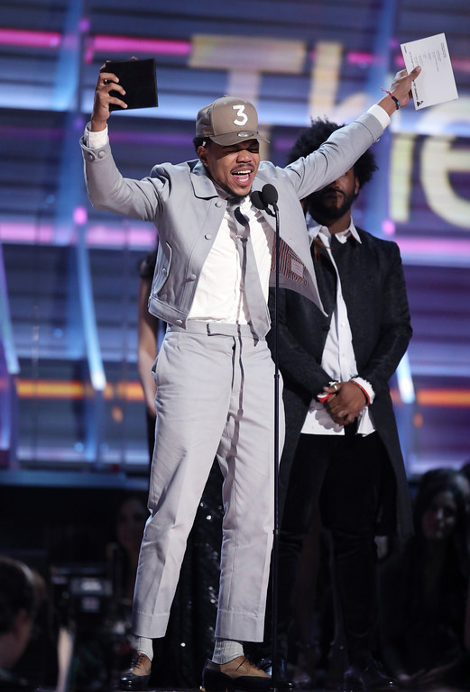 """. Chance The Rapper accepts the award for best rap album for \""""Coloring Book\"""" at the 59th annual Grammy Awards on Sunday, Feb. 12, 2017, in Los Angeles. (Photo by Matt Sayles/Invision/AP)"""