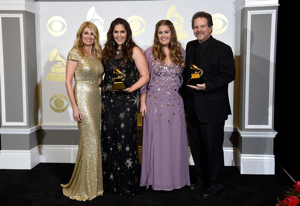 """. Linda Davis, from left, Hillary Scott, Rylee Scott, and Lang Scott pose in the press room with with the awards for best contemporary christian music album for \""""Love Remains\"""" and best contemporary christian music song for \""""Thy Will\"""" at the 59th annual Grammy Awards at the Staples Center on Sunday, Feb. 12, 2017, in Los Angeles. (Photo by Chris Pizzello/Invision/AP)"""
