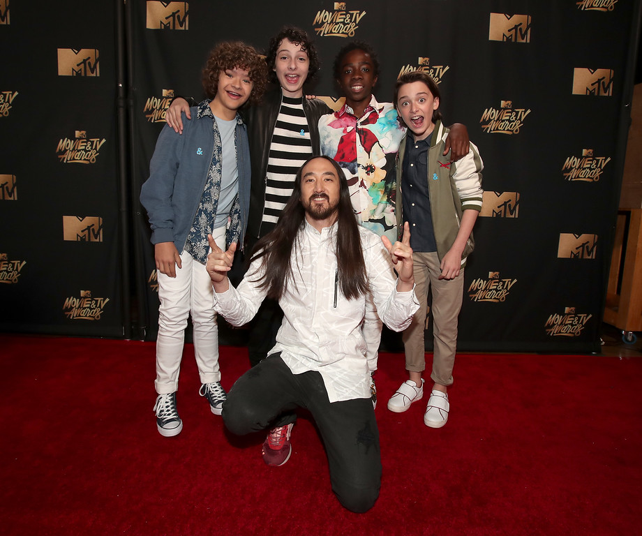 . LOS ANGELES, CA - MAY 07:  (L-R) Actors Gaten Matarazzo, Finn Wolfhard, musician Steve Aoki, and actors Caleb McLaughlin and Noah Schnapp attend the 2017 MTV Movie And TV Awards at The Shrine Auditorium on May 7, 2017 in Los Angeles, California.  (Photo by Christopher Polk/Getty Images)