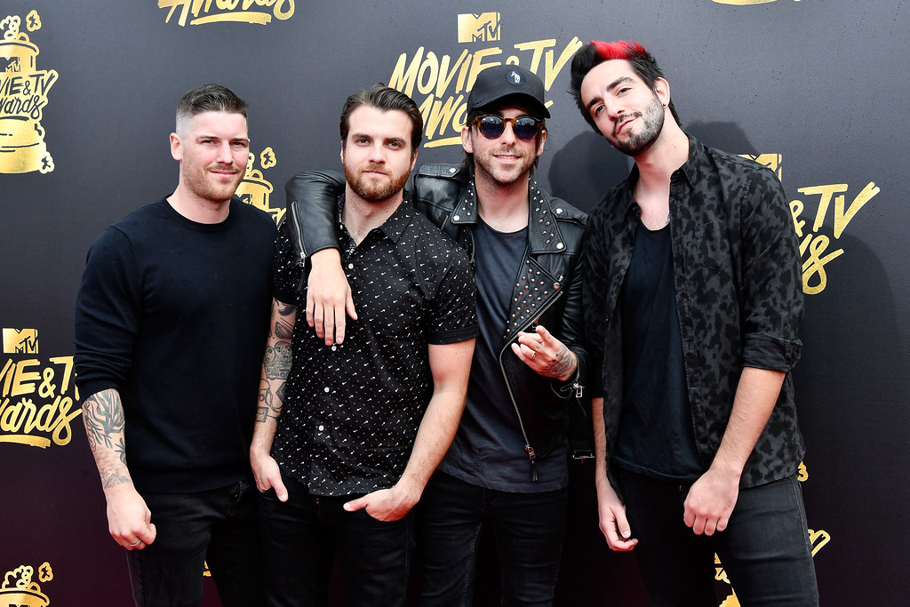 . LOS ANGELES, CA - MAY 07:  (L-R) Musician Zack Merrick, Rian Dawson, Alex Gaskarth and Jack Barakat of All Time Low attend the 2017 MTV Movie And TV Awards at The Shrine Auditorium on May 7, 2017 in Los Angeles, California.  (Photo by Frazer Harrison/Getty Images)