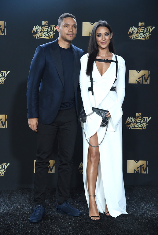 . Trevor Noah, left, and Jordyn Taylor arrive at the MTV Movie and TV Awards at the Shrine Auditorium on Sunday, May 7, 2017, in Los Angeles. (Photo by Richard Shotwell/Invision/AP)