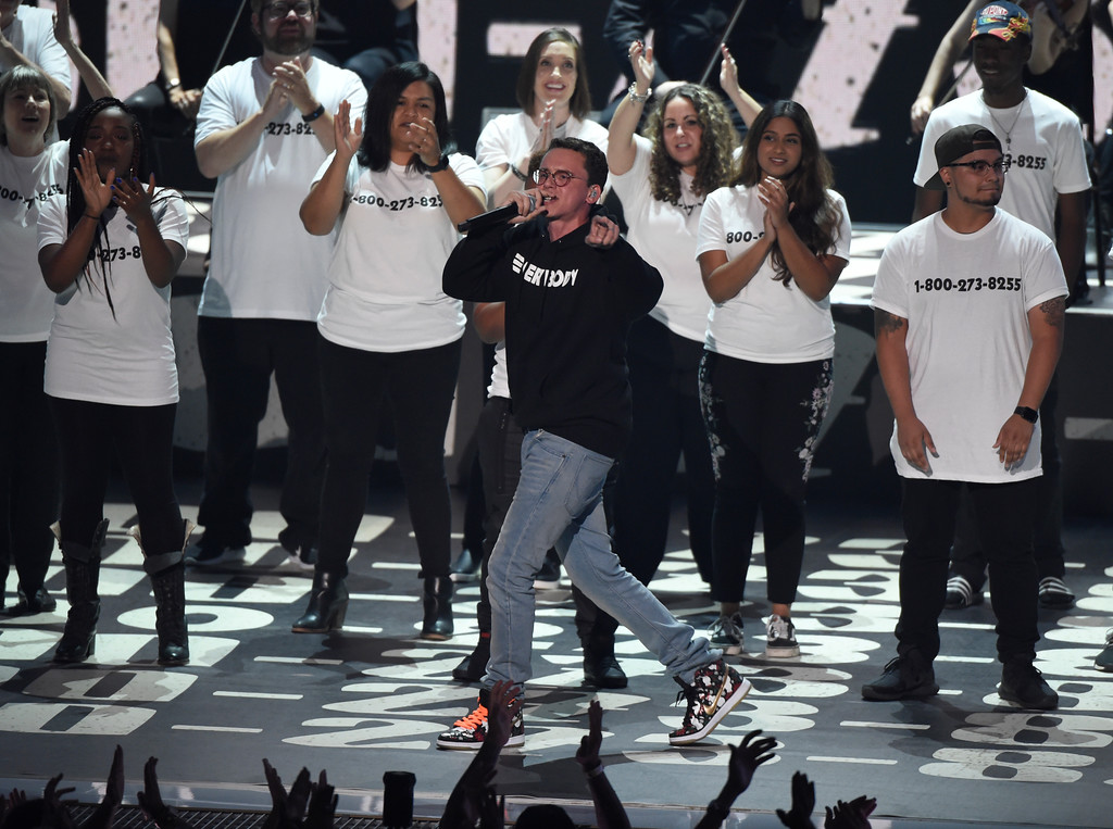 ". Logic performs ""1-800-273-8255\"" at the MTV Video Music Awards at The Forum on Sunday, Aug. 27, 2017, in Inglewood, Calif. (Photo by Chris Pizzello/Invision/AP)"