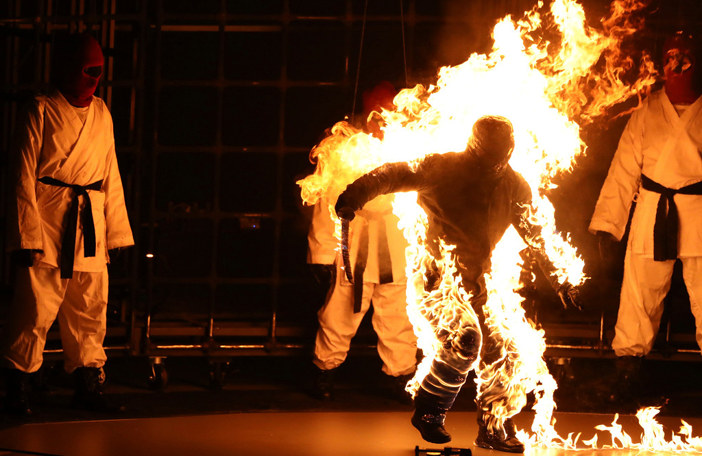. A dancer appears on stage on fire during a performance by Kendrick Lamar at the MTV Video Music Awards at The Forum on Sunday, Aug. 27, 2017, in Inglewood, Calif. (Photo by Matt Sayles/Invision/AP)