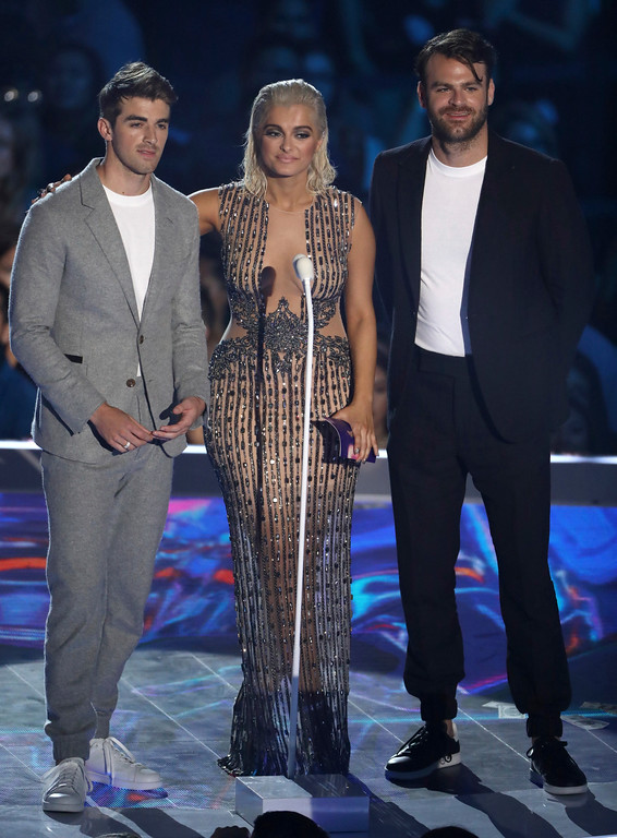 . Bebe Rexha, center, and from left, Andrew Taggart and Alex Pall, of The Chainsmokers, present the award for best new artist at the MTV Video Music Awards at The Forum on Sunday, Aug. 27, 2017, in Inglewood, Calif. (Photo by Matt Sayles/Invision/AP)