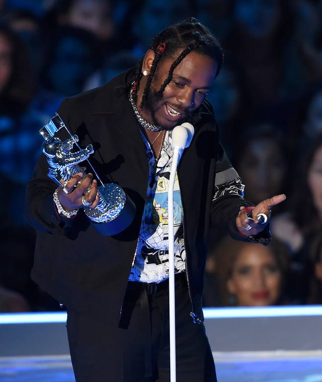 ". Kendrick Lamar accepts the award for video of the year for ""HUMBLE.\"" at the MTV Video Music Awards at The Forum on Sunday, Aug. 27, 2017, in Inglewood, Calif. (Photo by Chris Pizzello/Invision/AP)"