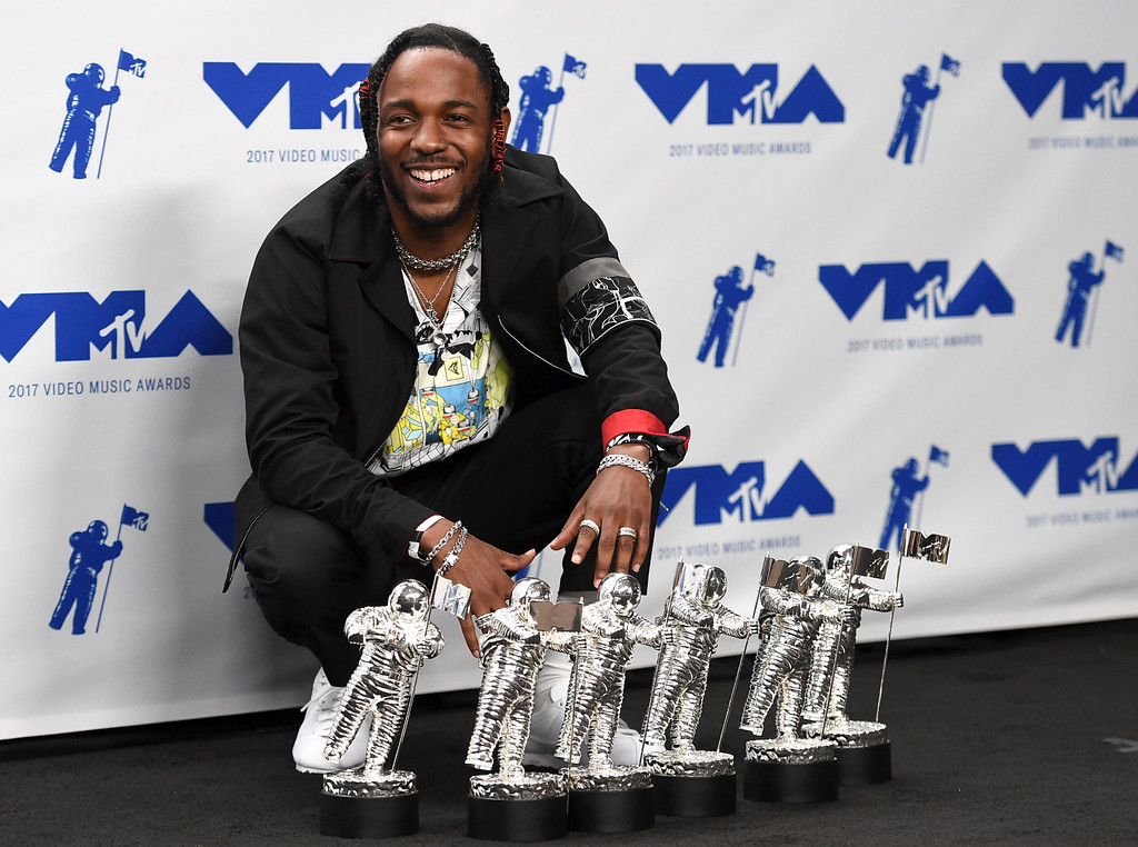". Kendrick Lamar poses in the press room with the awards for best hip hop video, best direction, best cinematography, best art direction, best visual effects, and video of the year for ""HUMBLE.\"" at the MTV Video Music Awards at The Forum on Sunday, Aug. 27, 2017, in Inglewood, Calif. (Photo by Jordan Strauss/Invision/AP)"