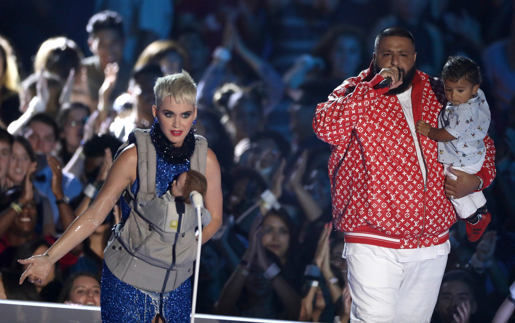 . DJ Khaled, right, and his son Asahd appear on stage with Katy Perry, left, during a skit at the MTV Video Music Awards at The Forum on Sunday, Aug. 27, 2017, in Inglewood, Calif. (Photo by Matt Sayles/Invision/AP)