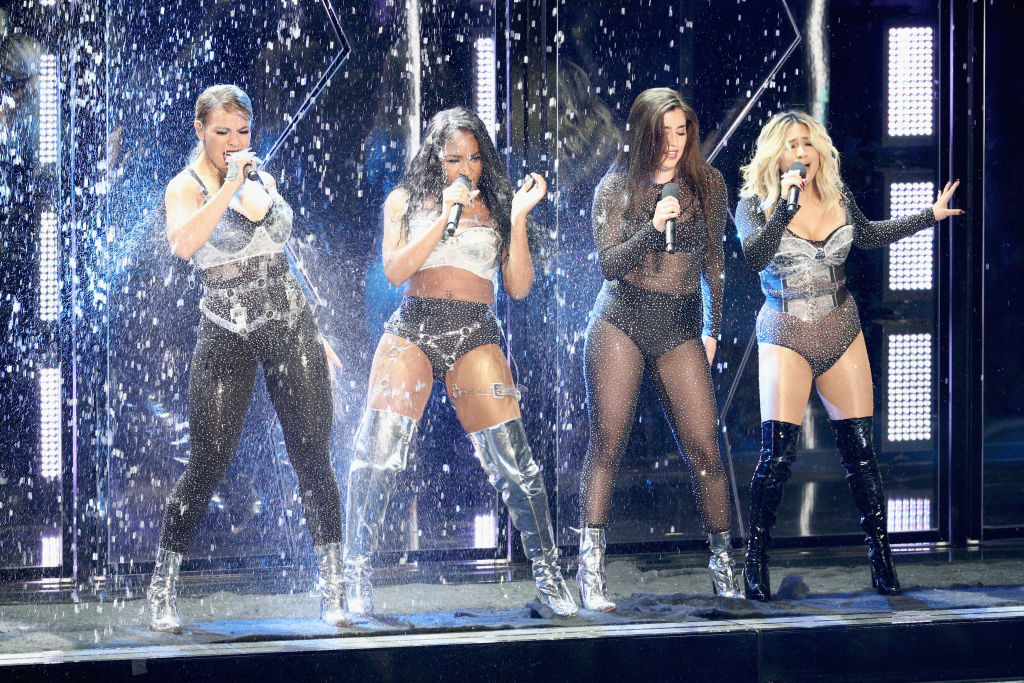 . INGLEWOOD, CA - AUGUST 27:  (L-R) Dinah Jane, Normani Kordei, Lauren Jauregui, and Ally Brooke of music group Fifth Harmony perform onstage during the 2017 MTV Video Music Awards at The Forum on August 27, 2017 in Inglewood, California.  (Photo by Frederick M. Brown/Getty Images)