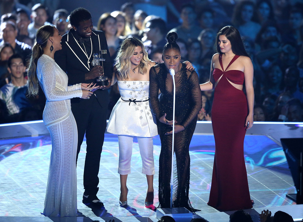 ". Gucci Mane, second from left, and from right Dinah Jane, Ally Brooke, Normani Kordei, and Lauren Jauregui of Fifth Harmony, accept the award for best pop video for ""Down\"" at the MTV Video Music Awards at The Forum on Sunday, Aug. 27, 2017, in Inglewood, Calif. (Photo by Matt Sayles/Invision/AP)"