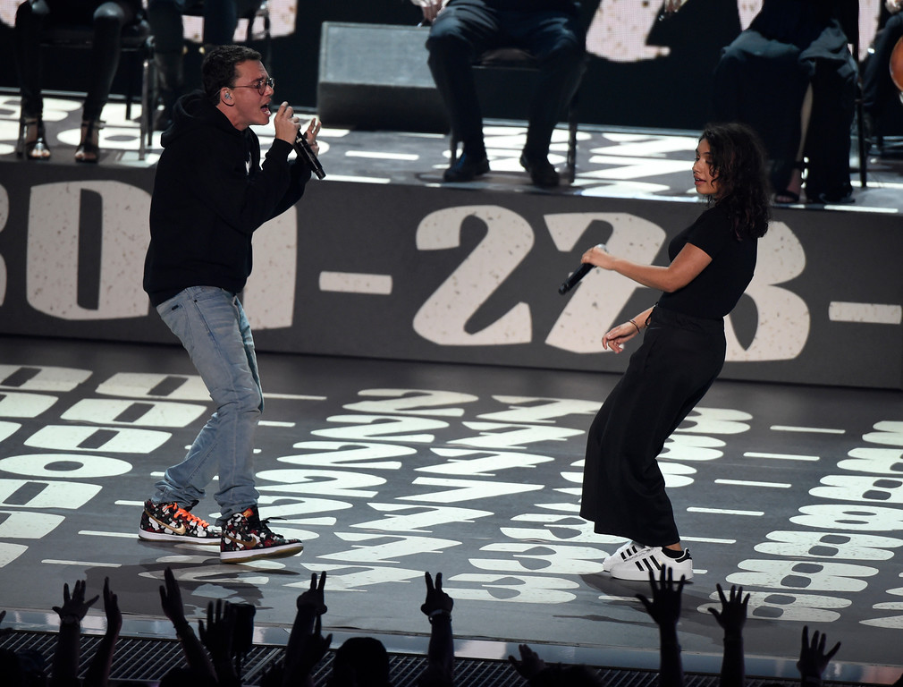 ". Logic, left, and Alessia Cara perform ""1-800-273-8255\"" at the MTV Video Music Awards at The Forum on Sunday, Aug. 27, 2017, in Inglewood, Calif. (Photo by Chris Pizzello/Invision/AP)"