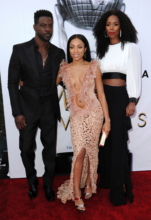 . Lance Gross, from left, Lil Mama and Tasha Smith arrive at the 48th annual NAACP Image Awards at the Pasadena Civic Auditorium on Saturday, Feb. 11, 2017, in Pasadena, Calif. (Photo by Richard Shotwell/Invision/AP)
