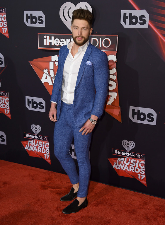 . Chris Lane arrives at the iHeartRadio Music Awards at the Forum on Sunday, March 5, 2017, in Inglewood, Calif. (Photo by Jordan Strauss/Invision/AP)