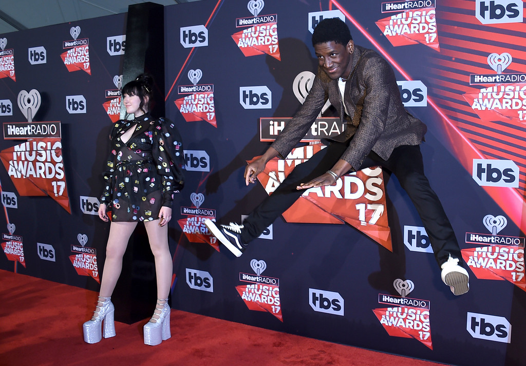 . Noah Cyrus, left, and Labrinth arrive at the iHeartRadio Music Awards at the Forum on Sunday, March 5, 2017, in Inglewood, Calif. (Photo by Jordan Strauss/Invision/AP)