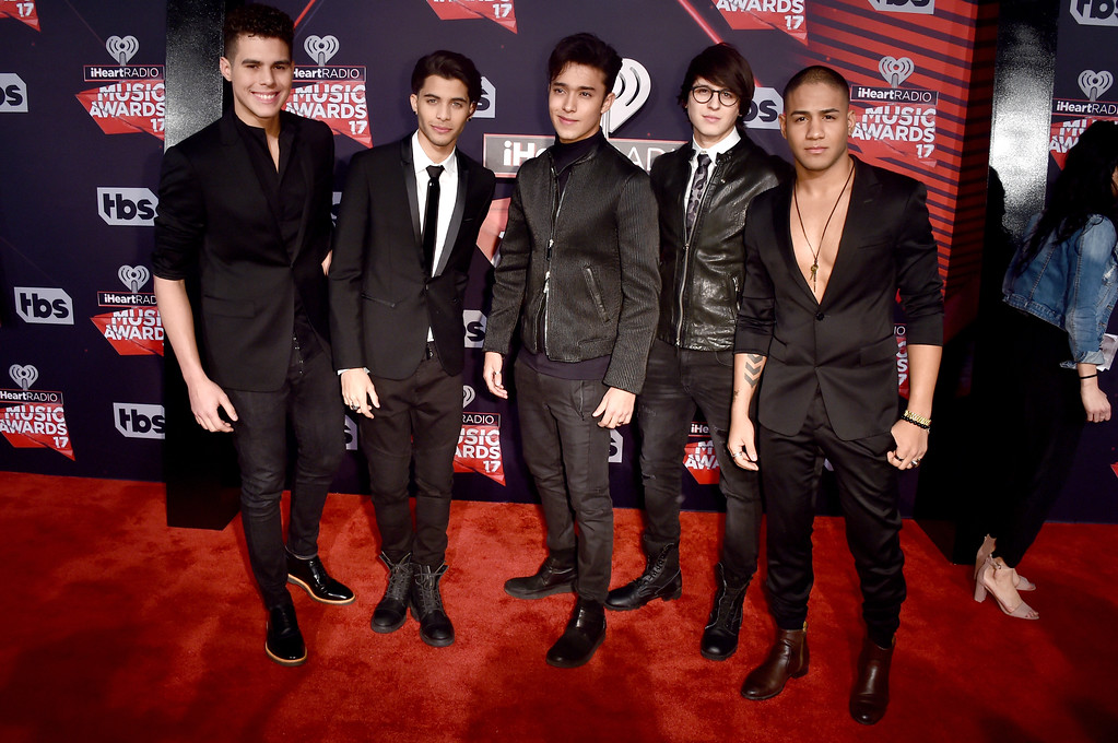 . INGLEWOOD, CA - MARCH 05:  (L-R) Singers Zabdiel de Jesus, Erick Brian Colon, Joel Pimentel, Christopher Velez and Richard Camacho of the group CNCO attend the 2017 iHeartRadio Music Awards which broadcast live on Turner\'s TBS, TNT, and truTV at The Forum on March 5, 2017 in Inglewood, California.  (Photo by Alberto E. Rodriguez/Getty Images)