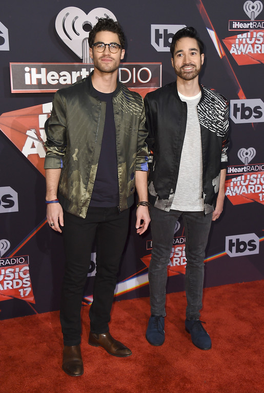 . Darren Criss, left, and Chuck Criss arrive at the iHeartRadio Music Awards at the Forum on Sunday, March 5, 2017, in Inglewood, Calif. (Photo by Jordan Strauss/Invision/AP)