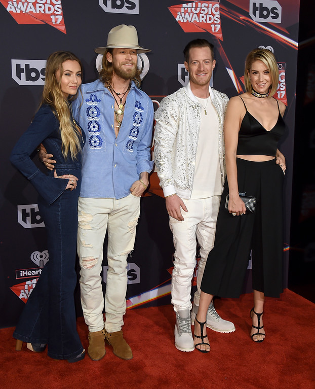 . Brian Kelley, center left, and Tyler Hubbard, center right, of Florida Georgia Line, and from left, Brittney Marie Cole and Hayley Stommel arrive at the iHeartRadio Music Awards at the Forum on Sunday, March 5, 2017, in Inglewood, Calif. (Photo by Jordan Strauss/Invision/AP)