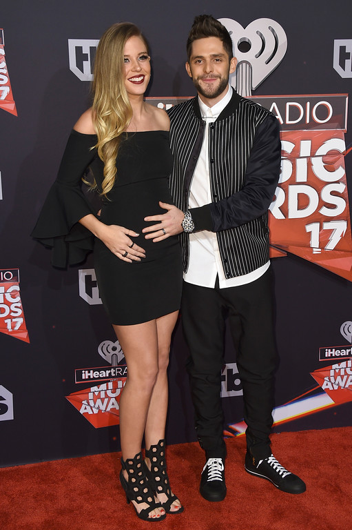 . Thomas Rhett, right, and Lauren Akins arrive at the iHeartRadio Music Awards at the Forum on Sunday, March 5, 2017, in Inglewood, Calif. (Photo by Jordan Strauss/Invision/AP)