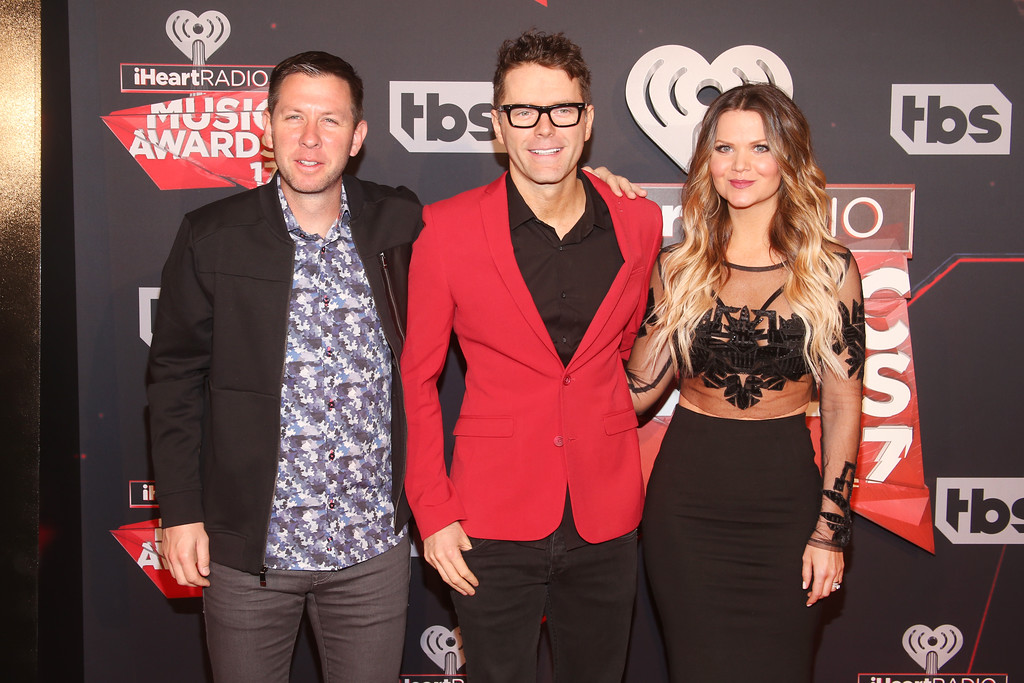 . INGLEWOOD, CA - MARCH 05:  (L-R) Radio personalities Lunchbox, Amy Brown, and Bobby Bones attend the 2017 iHeartRadio Music Awards which broadcast live on Turner\'s TBS, TNT, and truTV at The Forum on March 5, 2017 in Inglewood, California.  (Photo by Jesse Grant/Getty Images for iHeartMedia)